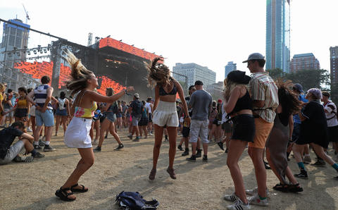 Festivalgoers dance to electronic dance music at Lollapalooza Saturday, Aug. 4, 2018, in Chicago.