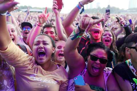 Fans sing to the music of Post Malone at Lollapalooza on Aug. 3, 2018, in Chicago.
