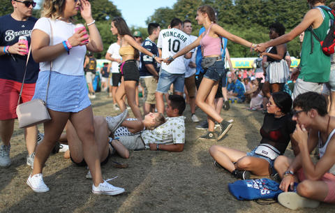 People rest before the Post Malone concert at Lollapaloozaon Aug. 3, 2018, in Chicago.
