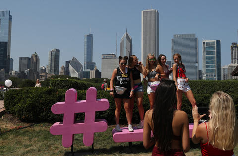 Festival goers pose for photographs at Lollapalooza on Aug. 3, 2018, in Chicago.