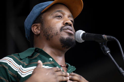 Durand Jones performs with his band Durand Jones & The Indications at Lollapalooza Sunday, Aug. 5, 2018, at Grant Park in Chicago.