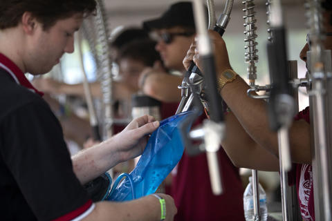Workers fill up water containers for festival goers on a hot day four of Lollapalooza Sunday, Aug. 5, 2018, at Grant Park in Chicago.