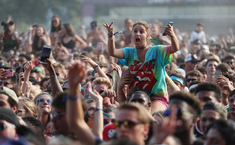 The crowd dances to Gucci Mane on Sunday, Aug. 5, 2018 at Lollapalooza in Grant Park.
