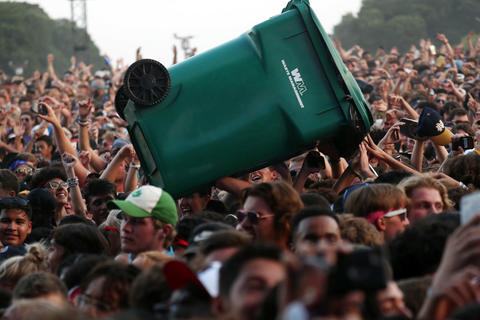 A trash can is surfed through the crowd during Lil Uzi Vert on Sunday, Aug. 5, 2018 at Lollapalooza in Grant Park.