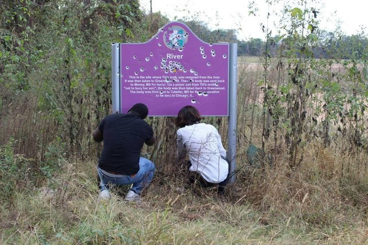 The spot where Emmett Till's body was found is marked by this sign. People keep shooting it up.
