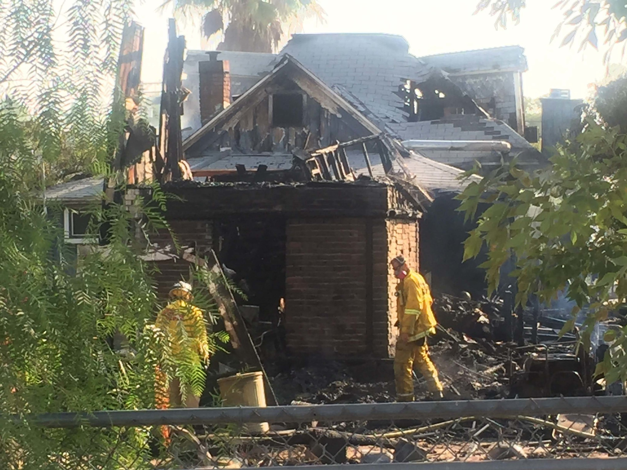 Firefighters remain at the scene of a fire that destroyed two structures in the 600 block of B Street Friday morning.