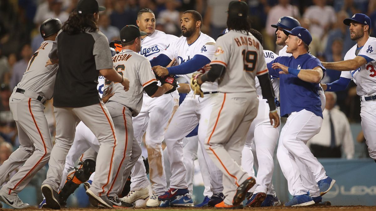 Benches clear and the Dodgers' bullpen gives it up yet again in 2-1 loss to Giants