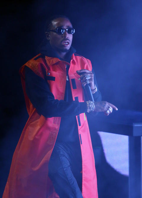 A member of Migos performs at the United Center in Chicago on Aug. 17, 2018.