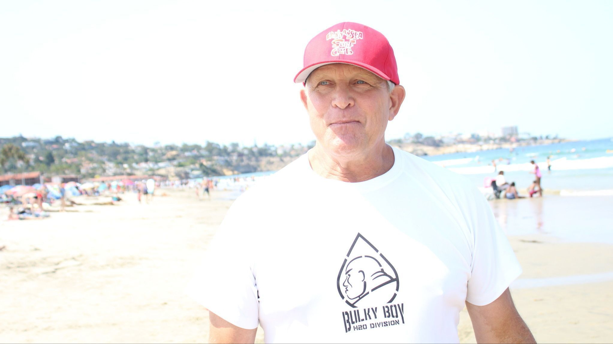 WindanSea Surf Club president Bill Fitzmaurice reflects on his club's history during its latest Day at the Beach charity event at La Jolla Shores.