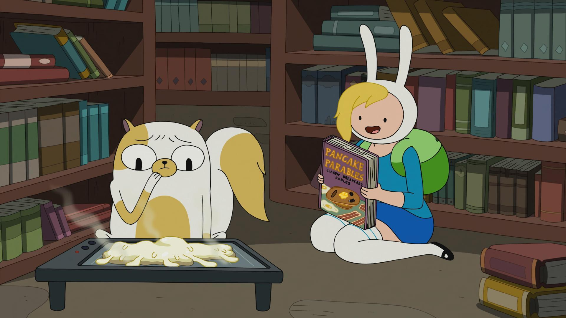 "A scene from Cartoon Network's ""Adventure Time."" Episode: Five Short Tables. Pictured are Cake the C"