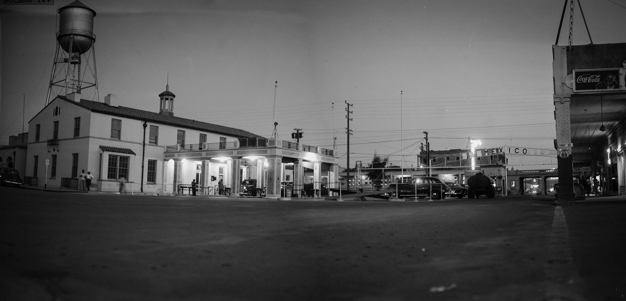 Border crossing at Mexicali-Calexico between California and Mexico at dusk. This is a panorama, made