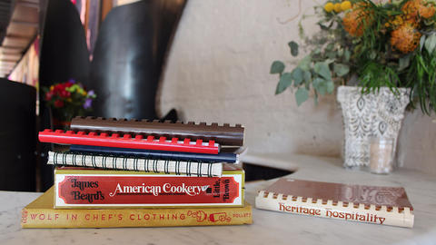 Spiral-bound vintage church, women's groups and classic cookbooks, part of chef Tim Graham's extensive collection.