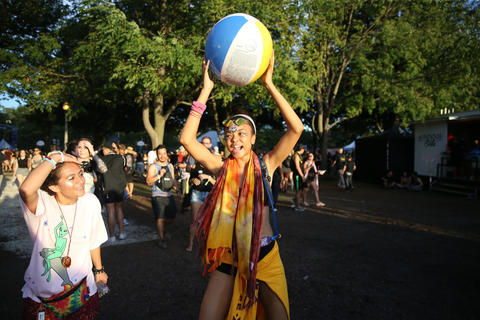 Concertgoers toss a ball during the North Coast Music Festivalon Sept. 2, 2018, in Chicago's Union Park.