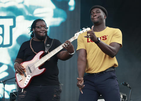 Jacob Banks, right, takes to the stage during the North Coast Music Festivalon Sept. 2, 2018, in Chicago's Union Park.