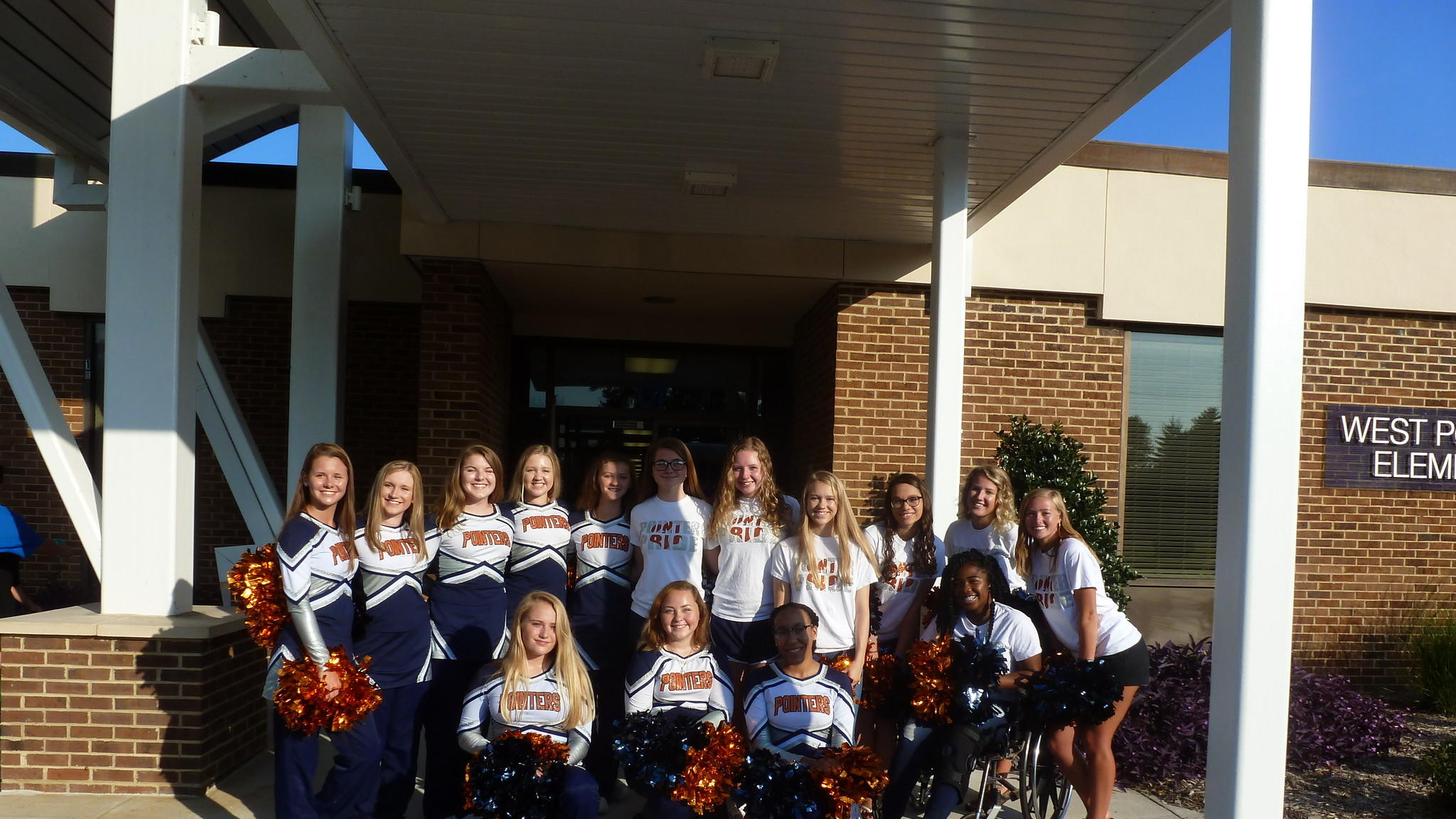 Cheerleaders welcome students to school