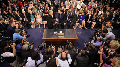 Chaos marks start of Kavanaugh Senate hearing as Dems call for delay after document dump