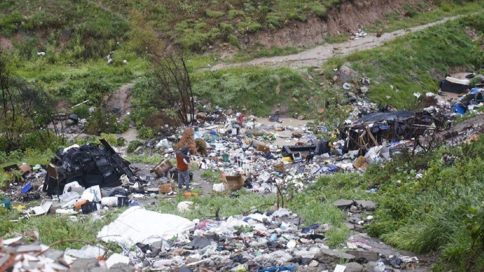 A valley in Tijuana strewn with garbage and wastewater.