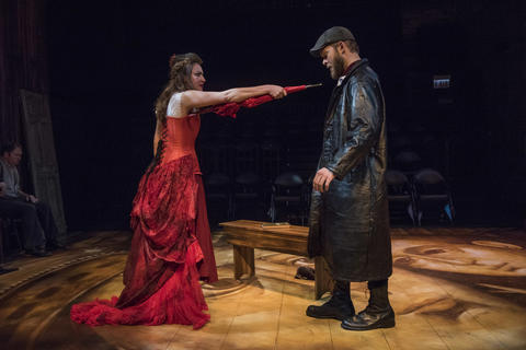 Ilse Zacharias and Drew Schad in Shattered Globe Theatre's new adaptation of Crime and Punishment.