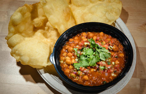 Chola bhatura at Tikkawala is a dish of stewed chickpeas and spiced tomato-and-onion gravy, served with fry bread.