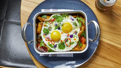 Free Rein's pork belly hash is made with mushrooms, potatoes and peppers.