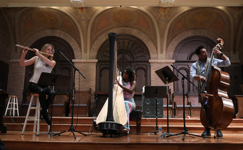 The Brandee Younger Trio, with Anne Drummond, from left, Brandee Younger and Rashaan Carter, performs at Hyde Park Union Church during the Hyde Park Jazz Festival on Sept. 29, 2018, in Chicago.