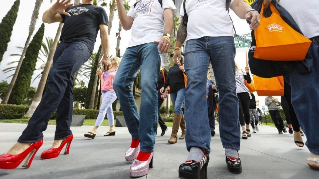 Men in heels strut — and totter — downtown to raise domestic violence awareness