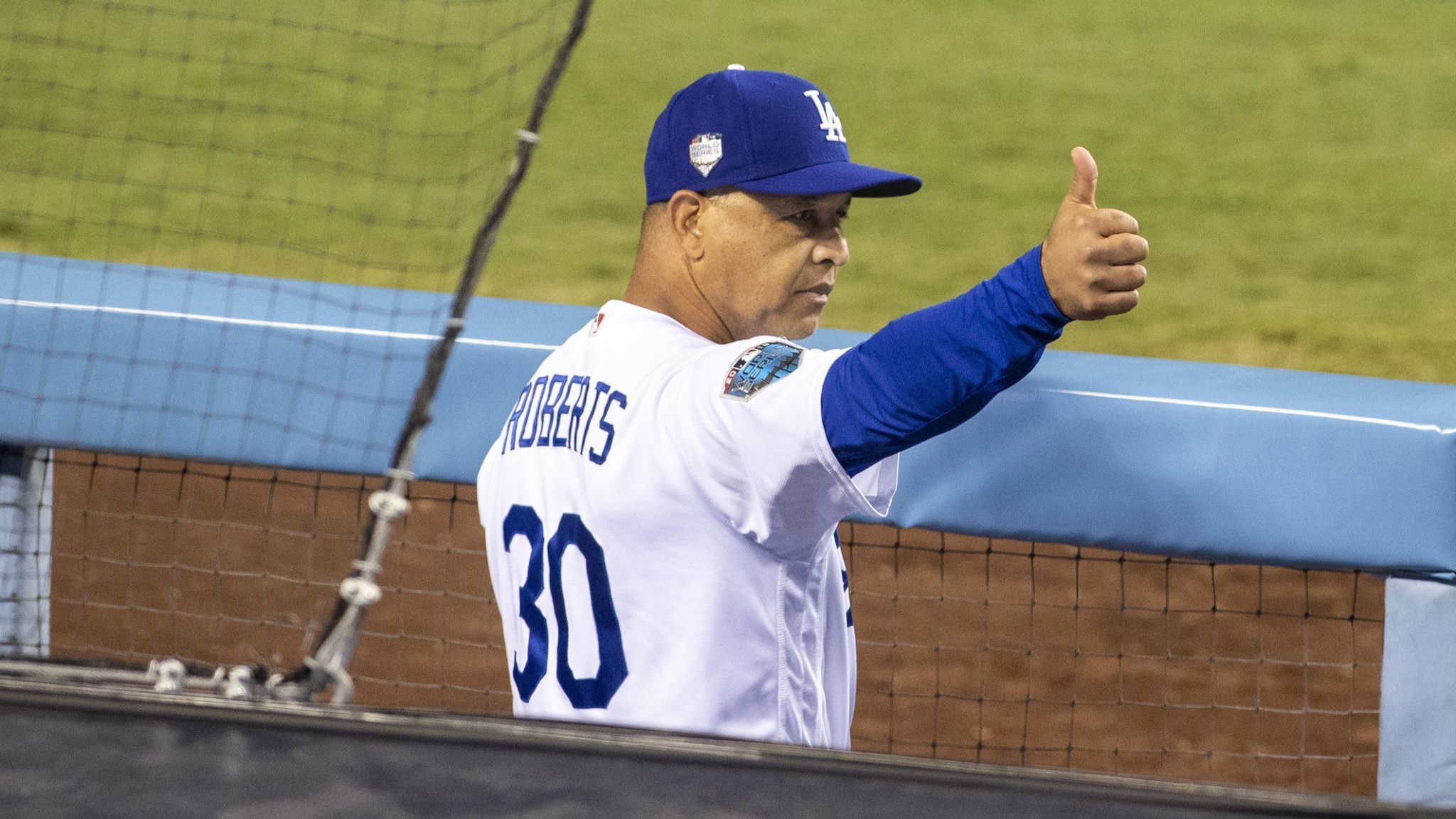 Dodgers pick up option on manager Dave Roberts' contract