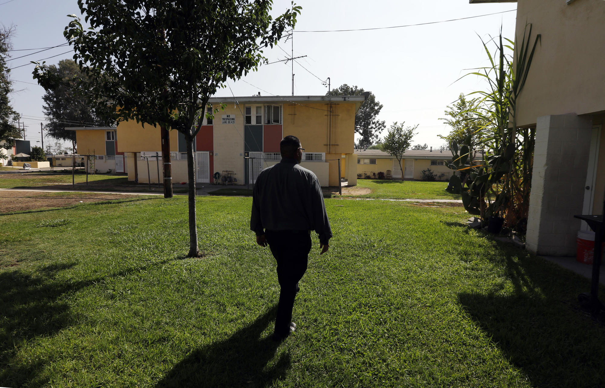 Jose Razo walks around San Fernando Gardens