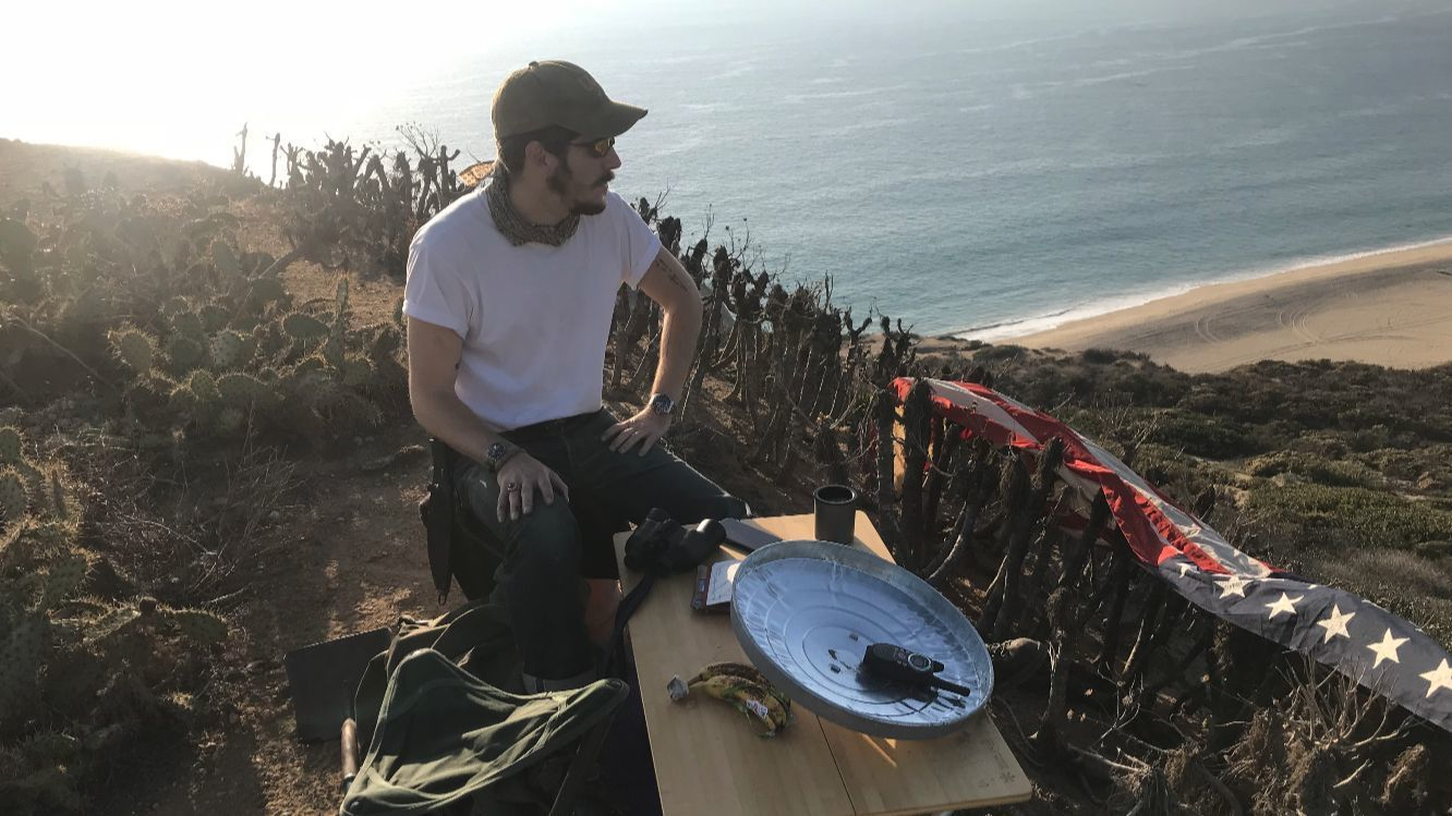 From atop Point Dume, a former Marine with binoculars, a radio and American flag tracks fires | Los Angeles Times