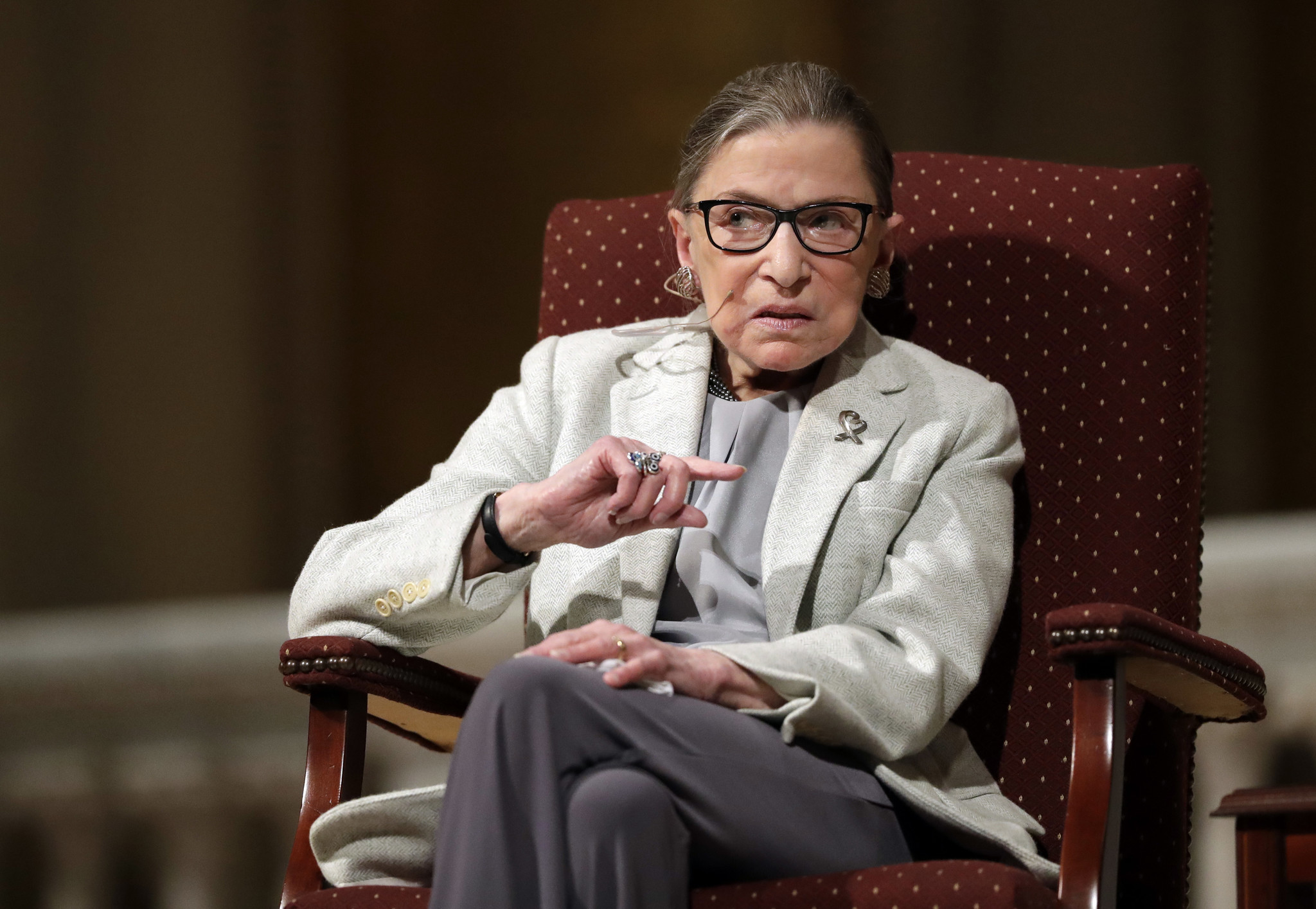 Ruth Bader Ginsburg improving after fall but misses court session