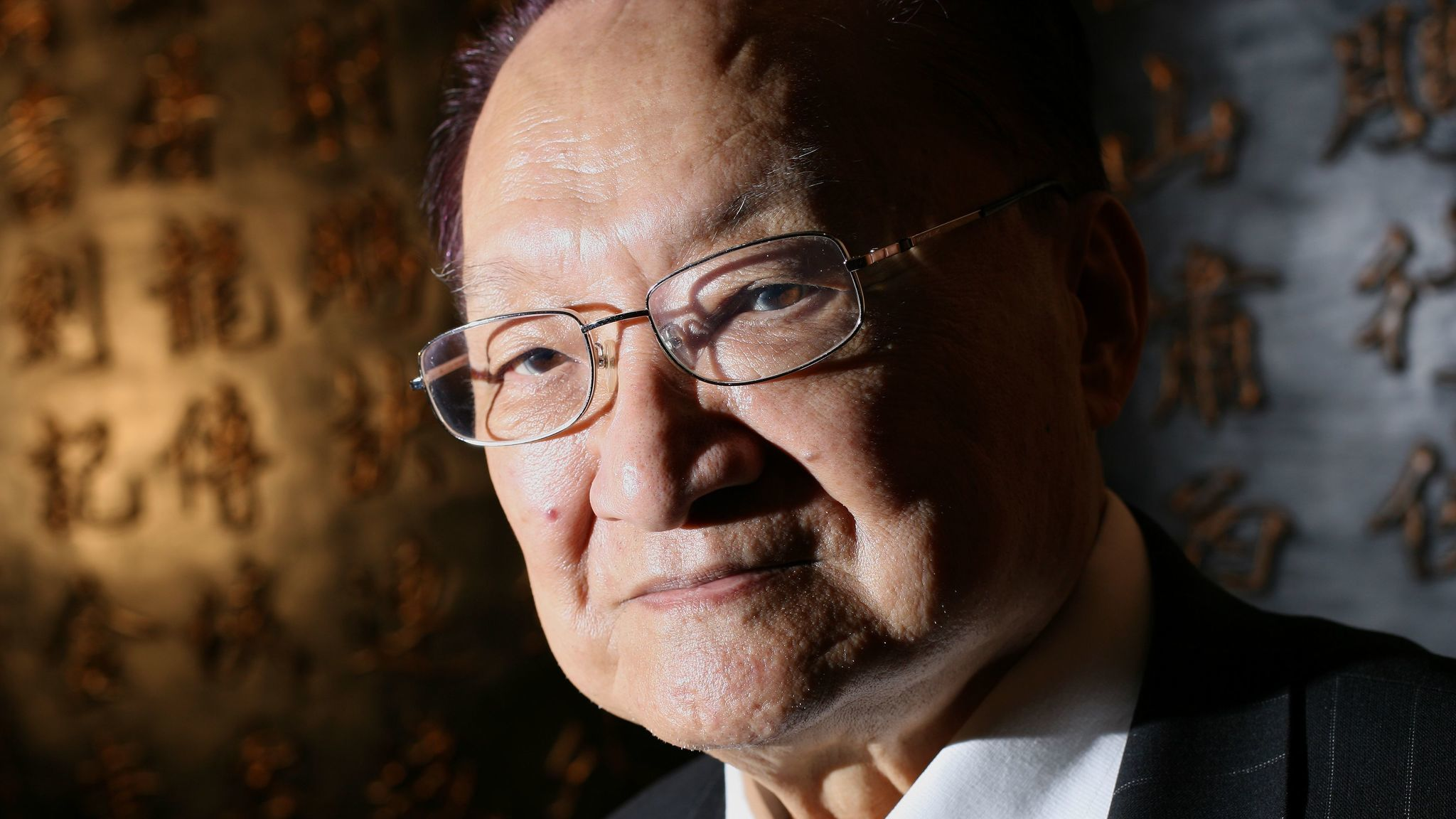 Hong Kong journalist, martial arts novelist Louis Cha dies at 94