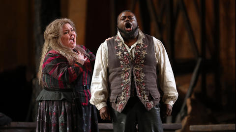 "Jamie Barton, left, plays Azucena and Russell Thomas plays Manrico during a dress rehearsal of a Lyric Opera of Chicago production of Giuseppe Verdi's ""Il trovatore"" at the Civic Opera House in Chicago on Wednesday, Nov. 14, 2018."