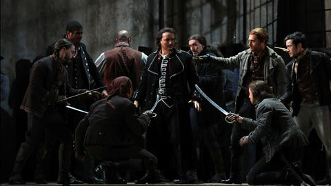"Artur Rucinski, center, plays Count di Luna during a dress rehearsal of a Lyric Opera of Chicago production of Giuseppe Verdi's ""Il trovatore"" at the Civic Opera House in Chicago on Wednesday, Nov. 14, 2018."