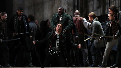 "Russell Thomas, standing, plays Manrico and Artur Rucinski, kneeling, plays Count di Luna during a dress rehearsal of a Lyric Opera of Chicago production of Giuseppe Verdi's ""Il trovatore"" at the Civic Opera House in Chicago on Wednesday, Nov. 14, 2018."