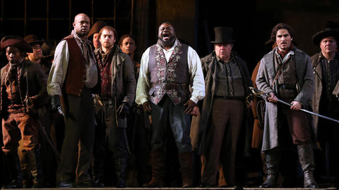 "Russell Thomas, center, plays Manrico during a dress rehearsal of a Lyric Opera of Chicago production of Giuseppe Verdi's ""Il trovatore"" at the Civic Opera House in Chicago on Wednesday, Nov. 14, 2018."