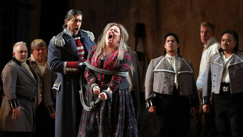 "Roberto Tagliavini left, plays Ferrando and Jamie Barton plays Azucena during a dress rehearsal of a Lyric Opera of Chicago production of Giuseppe Verdi's ""Il trovatore"" at the Civic Opera House in Chicago on Wednesday, Nov. 14, 2018."