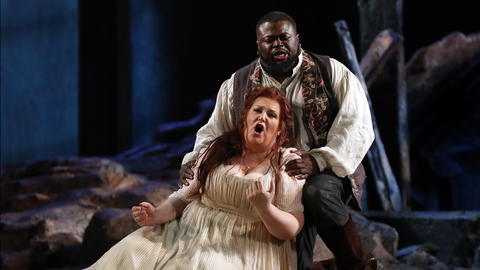 "Russell Thomas, top, plays Manrico and Tamara Wilson plays Leonora during a dress rehearsal of a Lyric Opera of Chicago production of Giuseppe Verdi's ""Il trovatore"" at the Civic Opera House in Chicago on Wednesday, Nov. 14, 2018."
