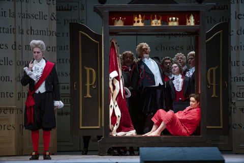 """Alice Coote as Prince Charming (seated) performs in a dress rehearsal Wednesday, Nov. 28, 2018 of Massenet's """"Cendrillon"""" at the Lyric Opera. (Brian Cassella/Chicago Tribune)"""