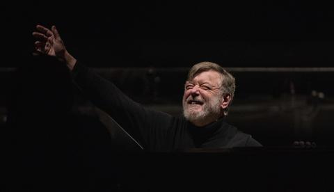 "Conductor Sir Andrew Davis waves before a dress rehearsal Wednesday, Nov. 28, 2018 of Massenet's ""Cendrillon"" at the Lyric Opera. (Brian Cassella/Chicago Tribune)"