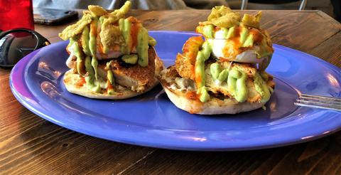 The Gringo's huevos benedict features an English muffin topped with hot fried chicken, poached egg, red salsa, avocado cream, potatoes and crispy jalapeños.