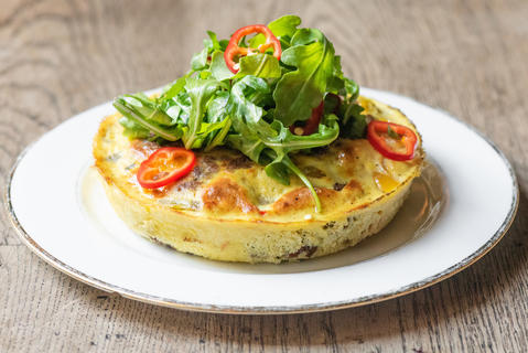 Quartino's new brunch menu includes this frittata featuring house-made spicy sausage and mozzarella, peppers, arugula and red fresno chilies.