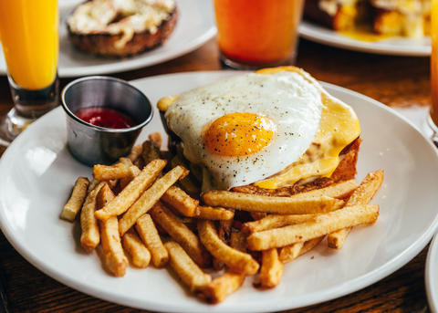 Schubas' Three Bees & Egg is brioche bread loaded with smoked bacon, brie cheese and a fried egg.