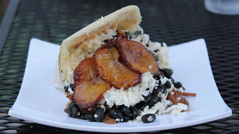 The pabellon arepa is stuffed with shredded beef, black beans, cheese and sweet plantains.