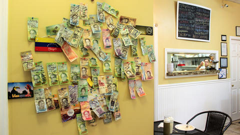 Banknotes decorate a wall in the cafe.