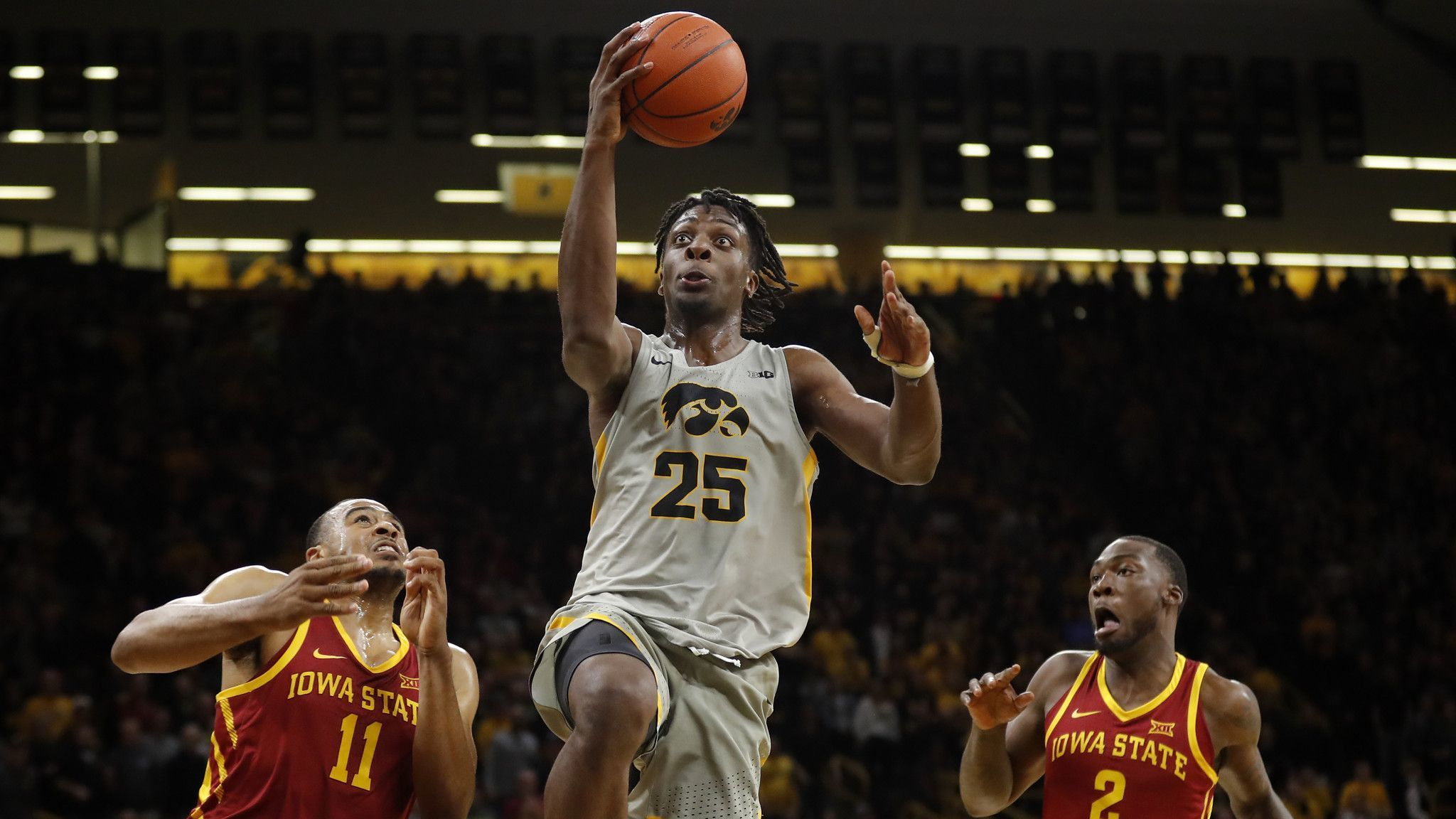 College basketball: Tyler Cook has 26 points, No. 18 Iowa beats Iowa State 98-84