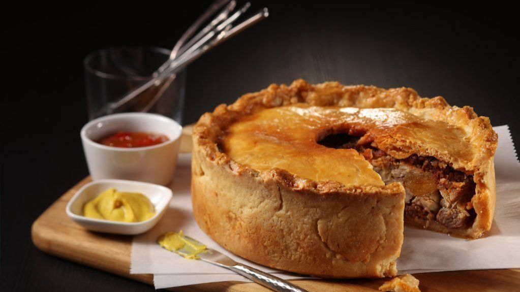 As American as apple pie? How about: As British as pork pie?