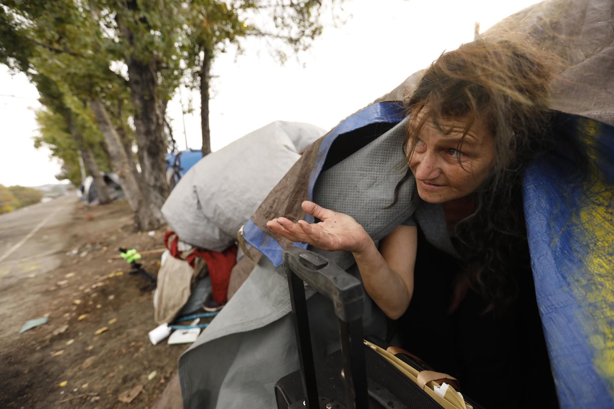 Melissa Millner checks for rain