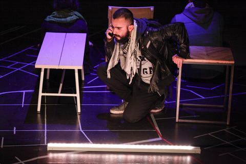 "Salar Ardebili in Interrobang Theatre Project's ""I Call My Brothers,"" on stage at the Rivendell Theater in Chicago."