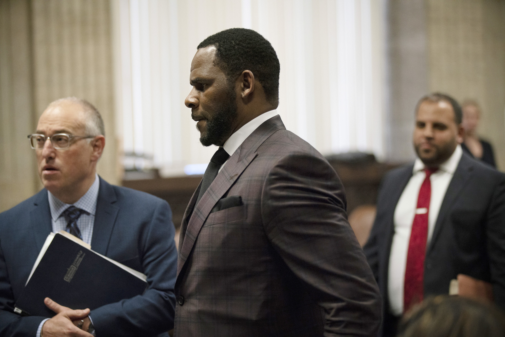 Singer R. Kelly charged in Cook County with aggravated criminal sexual abuse