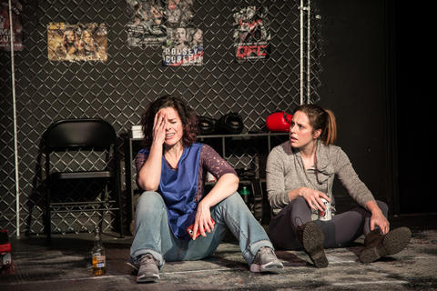 Michelle Courvais and Elise Marie Davis in Broken Nose Theatre's Chicago premiere of Girl in the Red Corner at the Den Theatre.